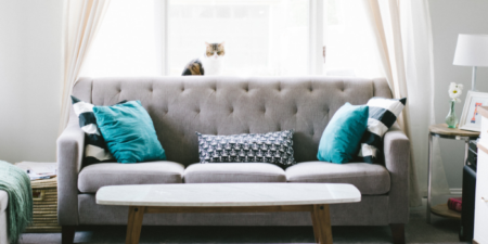 grey couch with blue pillows