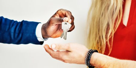 Man giving keys to couple