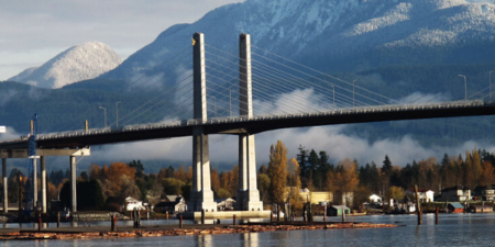 golden ears bridge with mountains in background